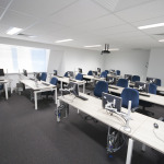 Blue computer lab at Sitting Rooms in Perth